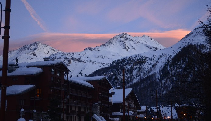sunset over snow covered mountains in val d'isere
