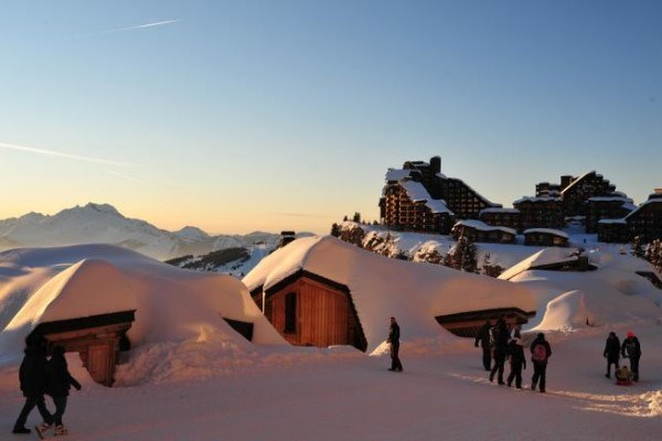 sunset in Avoriaz snow covered chalets