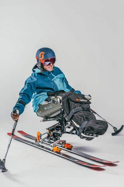 person doing solo sit skiing