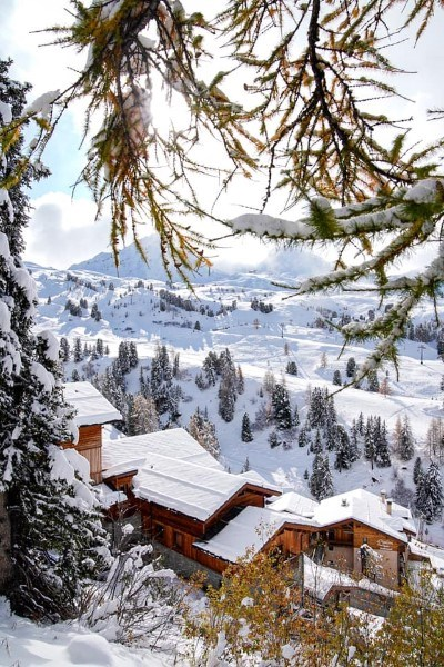 chalets in la plagne covered in snow