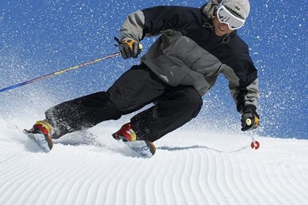 man skiing with carving skis